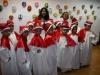 Alumnos de la Asociación Comunitaria Hilarte cantaron villancicos durante la muestra pictorica en el Museo LANN